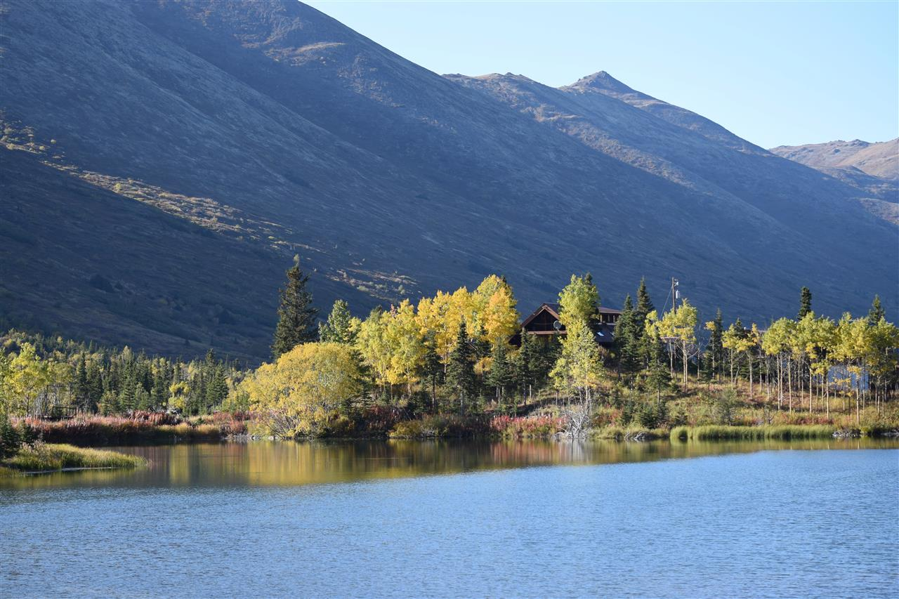 Autumn Splendor. Eagle River, Alaska on a private homestead property. The home is nestled in the trees just above the lake!