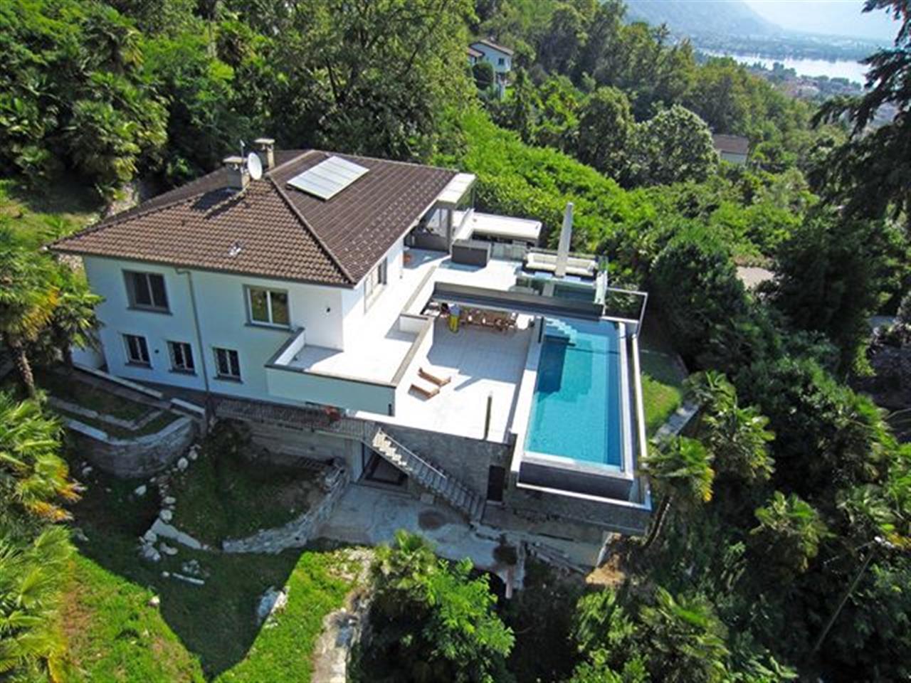 Villa within large park in privileged position above Locarno  #lakemaggiore #ticino #switzerland