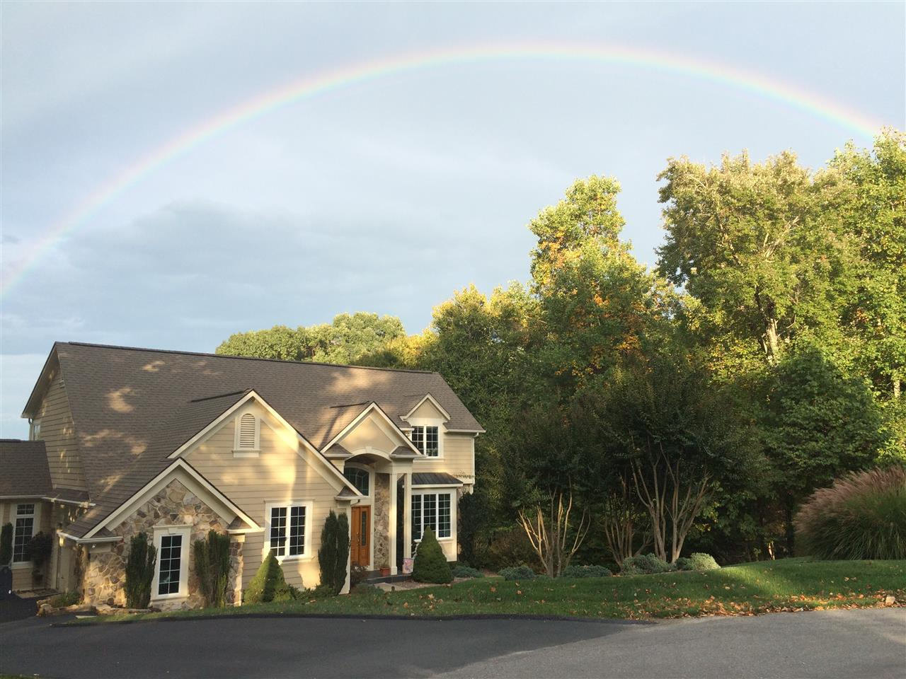 Rainbow over a home at Smith Mountain Lake, VA