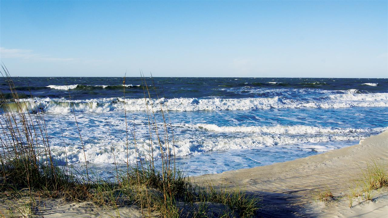 Serene beaches that look out onto crisp deep blue water of the Atlantic Ocean.