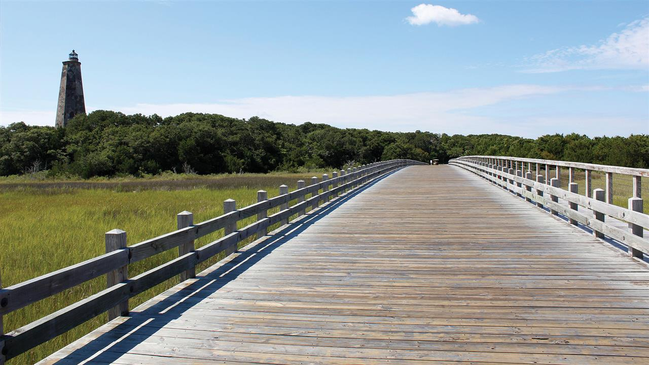 There's no bridge to the Island, but on the Island you may cross this beautiful wooden bridge over the creek.