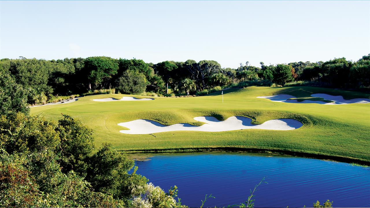 Beautiful golf course set with blue lagoons.