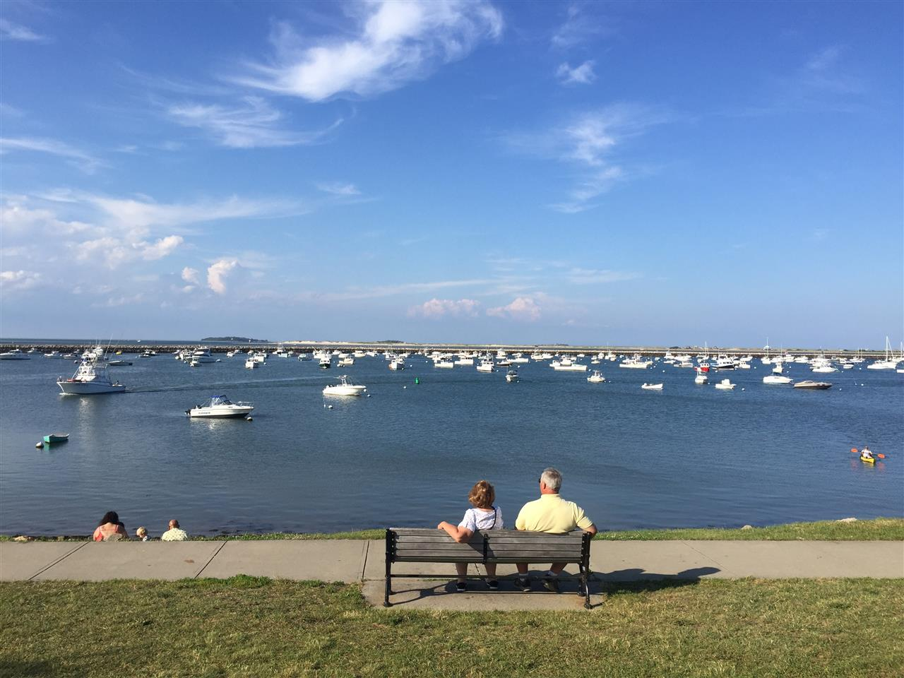 Couple watching the boats and waves on Plymouth Harbor, Plymouth MA