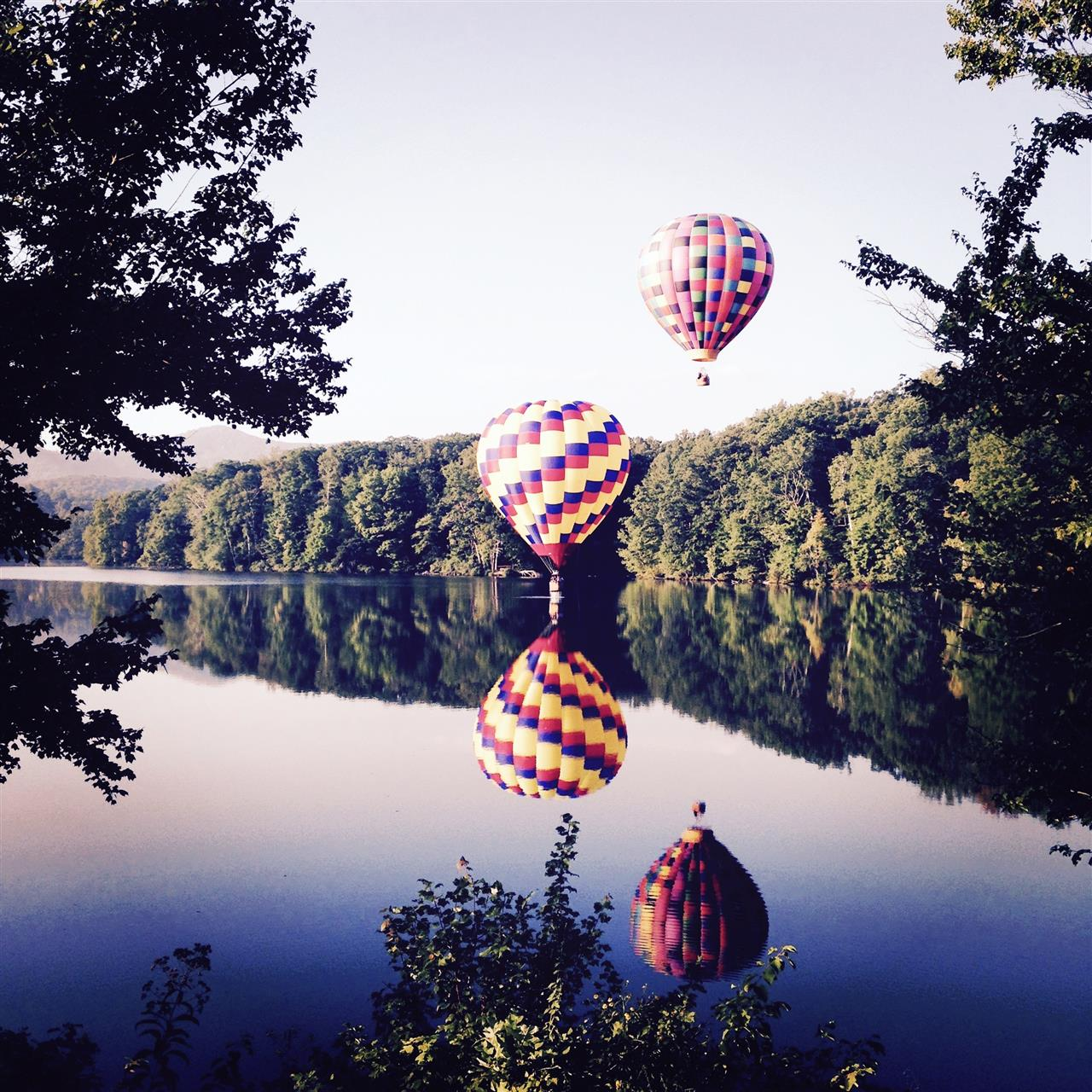 Touch down of hot air balloons in Biltmore Lake, Asheville NC.