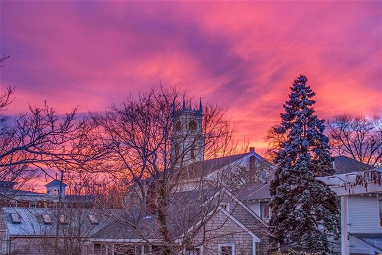 A gorgeous, colorful sunset over the clock tower of the Old Whaling Church in Edgartown! #GreetingsfromMV
