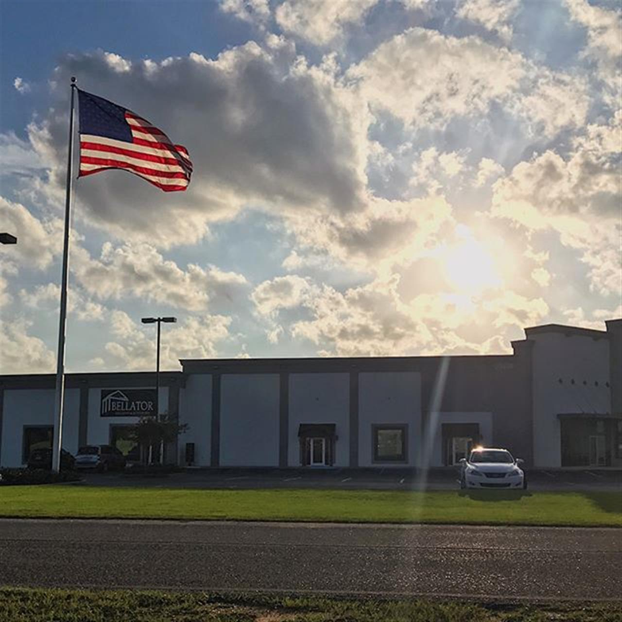 Soft, sunny skies over the @bellatorrealestate home office tonight. It's always humbling to step out of the office and see this incredible flag in the evening sunlight.  #alabamarealestate #gulfcoast #sunsets #veteranowned #americathebeautiful?? #leadingrelocal