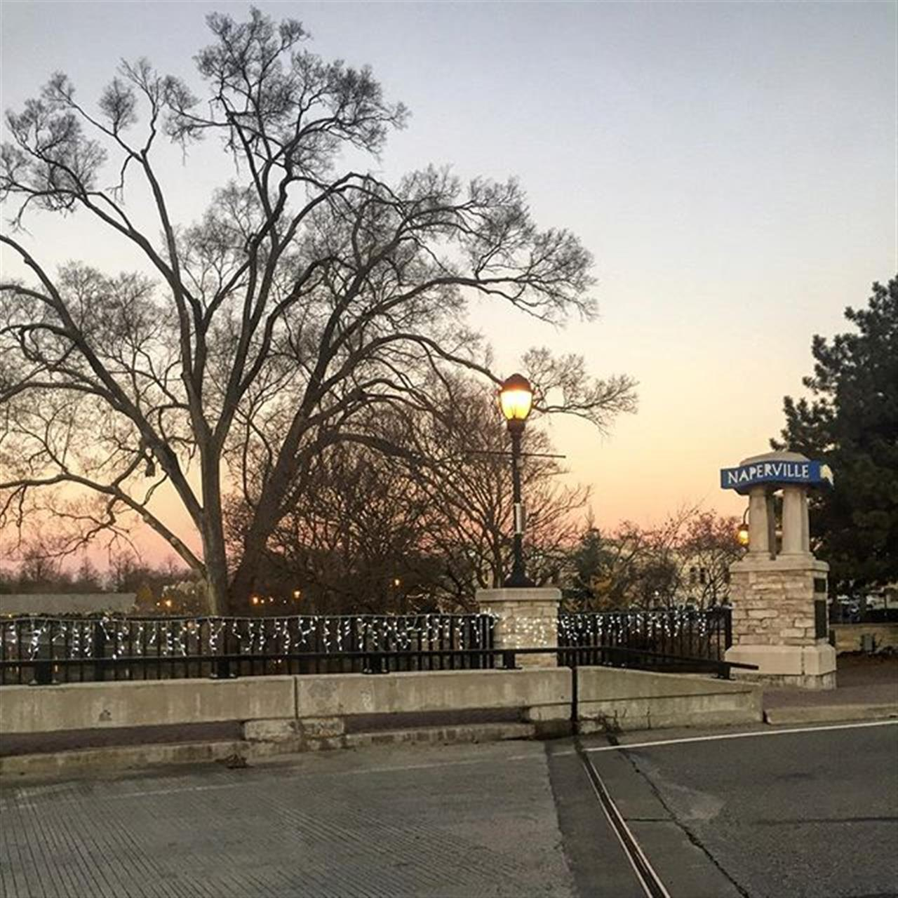 Sunrise over @napervilleil holiday decorations. It's that festive time of year in Chicagoland's popular suburb. #naperville #chicagosuburbs #leadingrelocal #bairdwarner #realestate #riverwalk #sunrise #commutershot #commuters