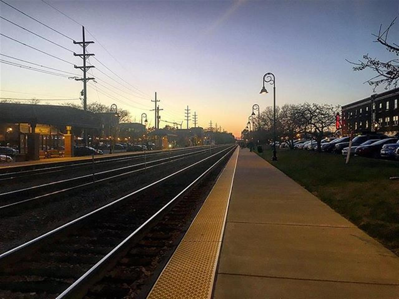 Chicago's suburbs follow the train tracks. Downers Grove's downtown is split by the tracks. On either side are restraints, shops, a theater, library parks and more. #chicagosuburbs #metra #downersgrovd #westernsuburbs #leadinrelocal #bairdwarner #bnsf #sunset #tivolitheatre #everydaysasunday