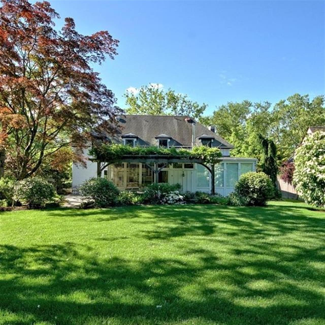 This backyard provides an inviting expanse of green lawn bordered by flowering trees and plants. . 158 Terhune Road Princeton, NJ http://bit.ly/2z3HYWu
