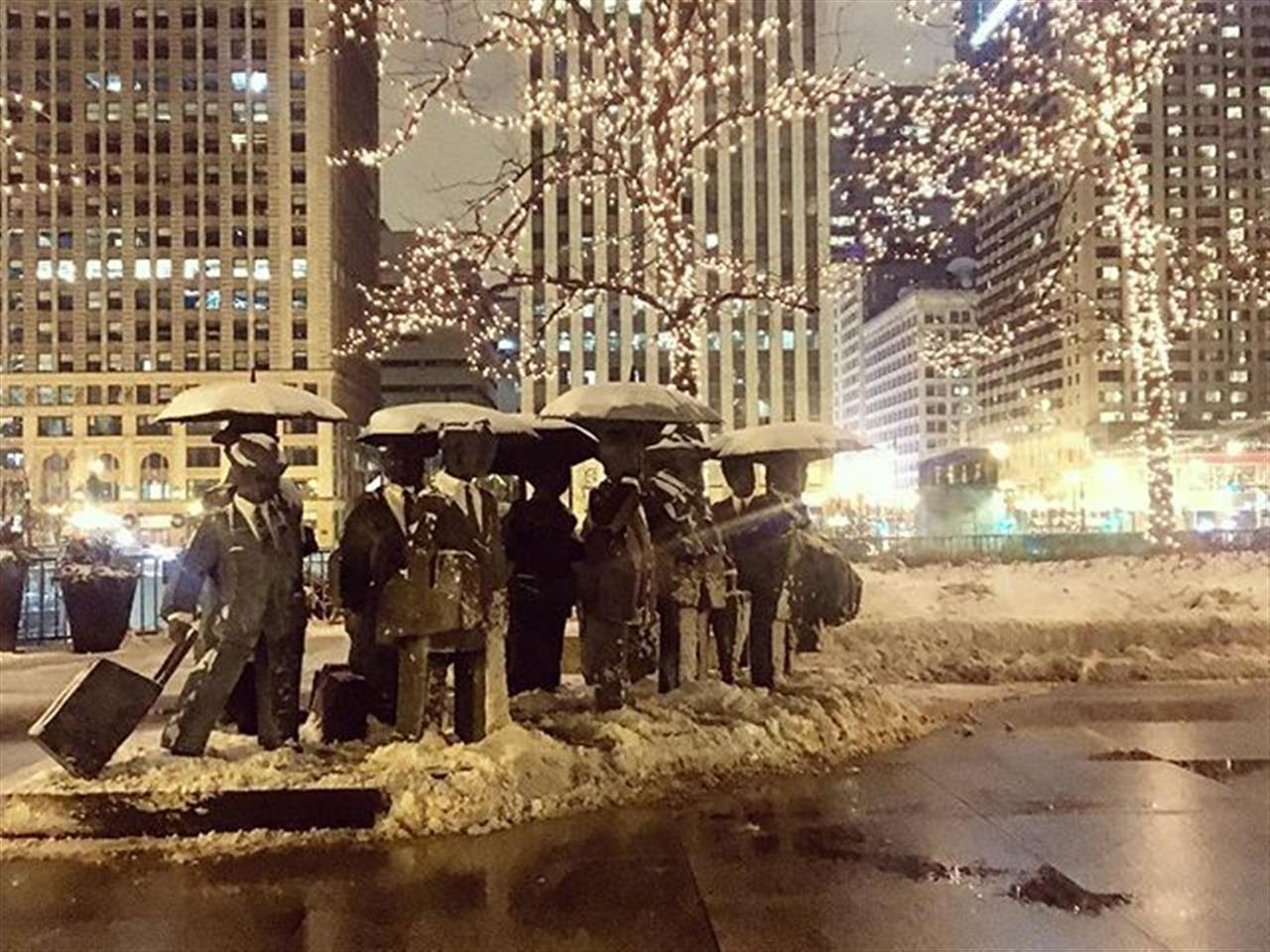Business men and travelers trudging through #Chicago snowfall. #winter #snow #loop #rivernorth #chicagoart #publicart #bairdwarner #leadingrelocal #walkingabout #lights #chicagoriver