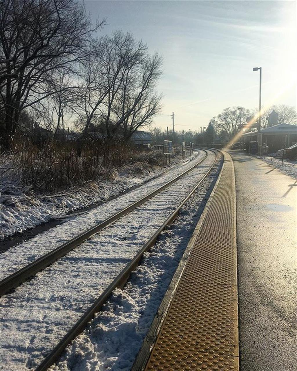 Snowfall and rain tracks. The promise of a fresh start and a new journey. #chicago #libertyville #metra #train #snowfall #leadingrelocal #chicago #neighborhoods #bairdwarner