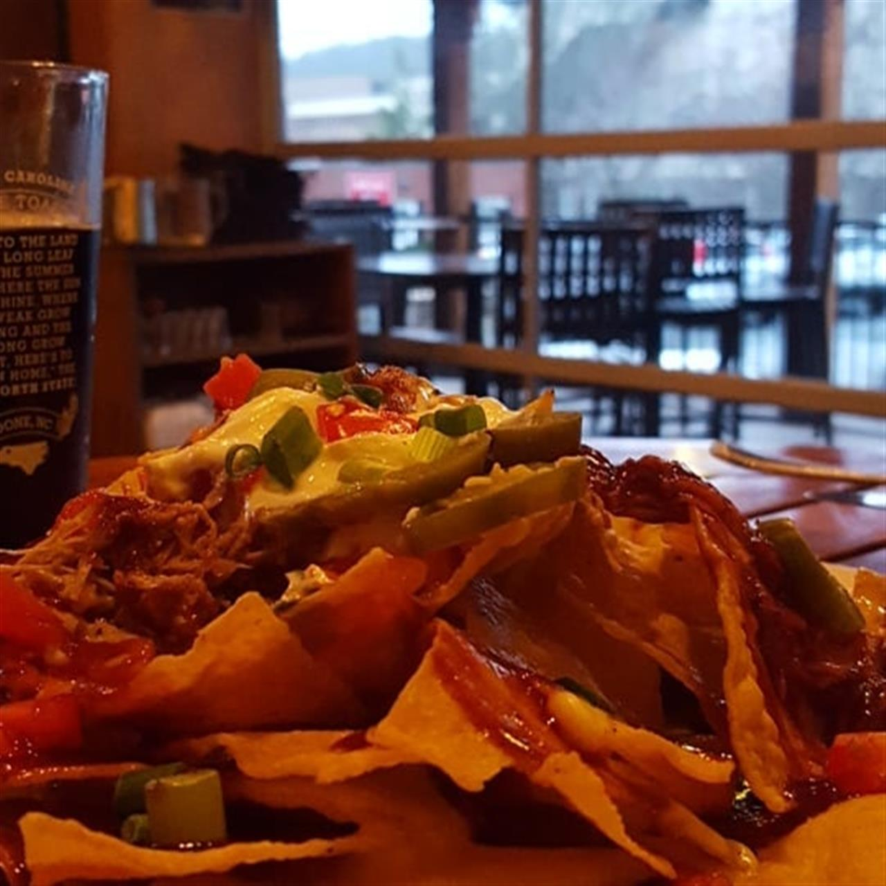 The pulled pork nachos at @thelocalboone are to DIE for! Paired with a local Belgian Trippel and we have dinner :-) #CarlsonRealtors #LeadingRELocal #BlowingRock #Boone #HighCountryHomeSpecialist #RealEstate #NCHighCountry #NCMountains #Realtorlife #BooneNC