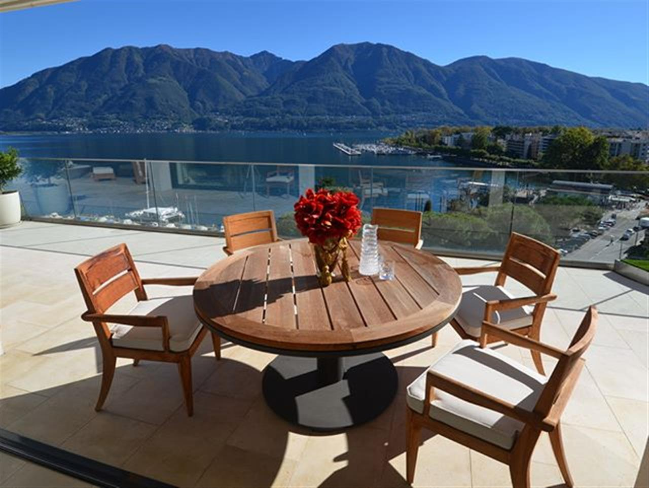 Summer in #Locarno Part III. Large terrace view incredible 180┬░ view to the #Locarno lake shore from one of our modern #apartmentforsale in #Muralto - #Ticino in #Switzerland at #LakeMaggiore - For more search with ref. 88334 or visit bit.ly/88334-en #luxuryrealestate #inlovewithswitzerland #luxurylife #luxurylifestyle #christiesinternationalrealestate #luxuryportfolio #wetagconsulting #leadingre #ChristiesHomes #LeadingRElocal