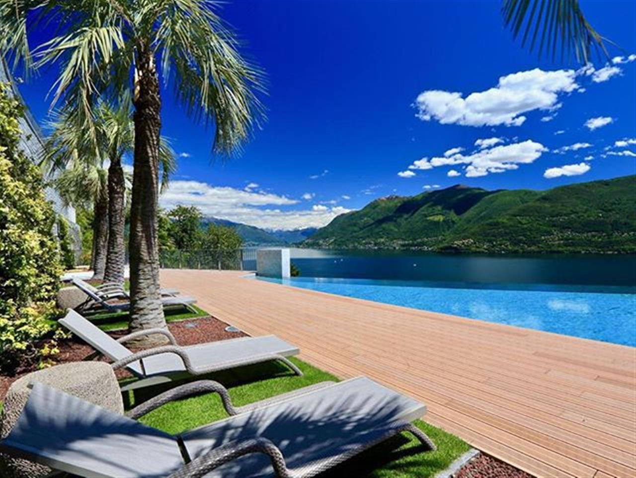 We can't wait for summer in #Ticino. This beautiful pic is from a luxury #apartmentforsale in #Brissago, #Switzerland at #LakeMaggiore - For more information about this apartment, please search with ref. 88407 at our website or visit bit.ly/88407-en  #luxuryrealestate #inlovewithswitzerland #luxurylife #luxurylifestyle #christiesrealestate #luxuryportfolio #wetagconsulting #leadingre #ChristiesHomes #LeadingRElocal