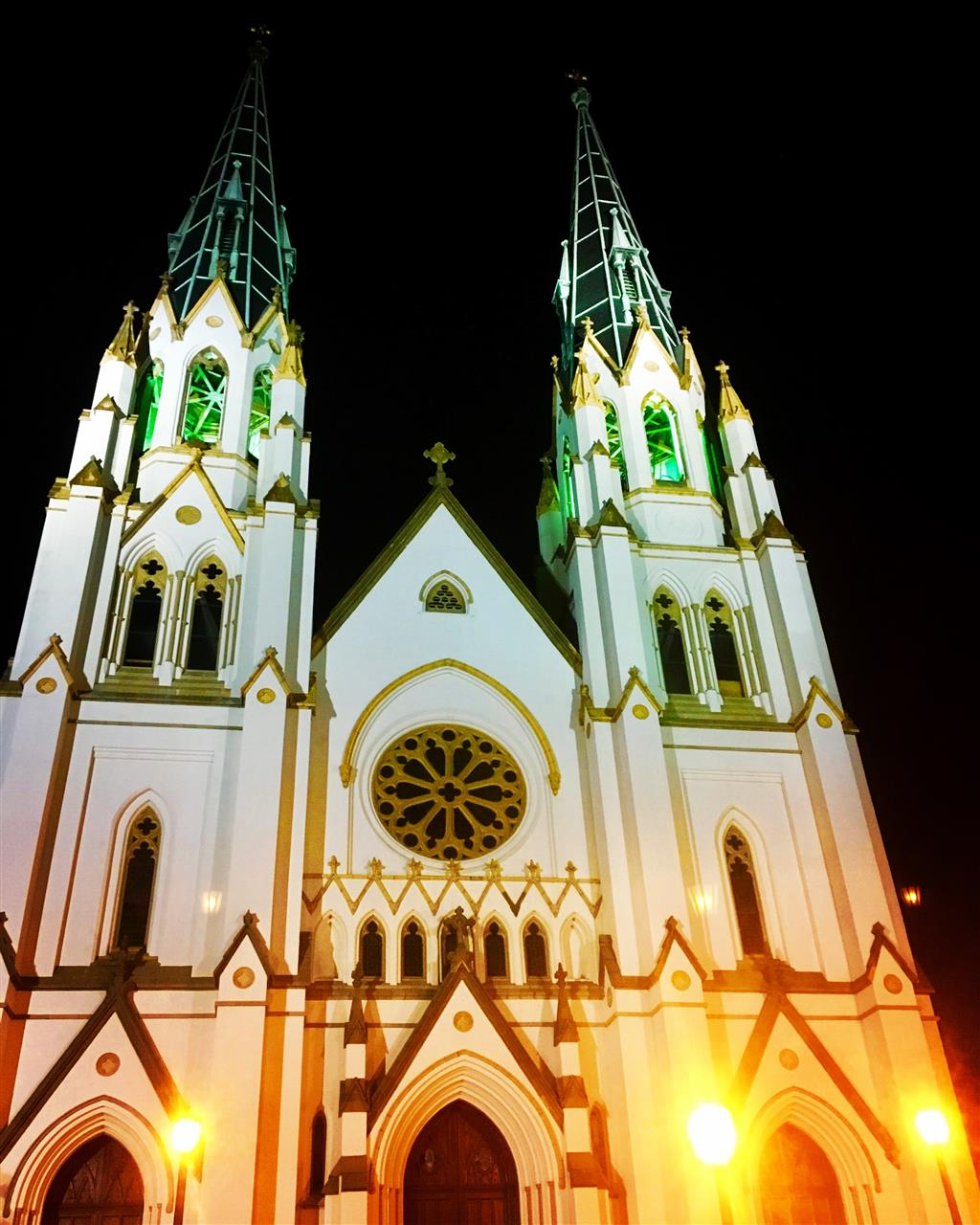 The Cathedral lit up at night in green, waiting on the arrival of St. Patrick